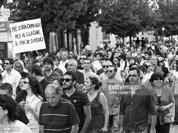 CONTENT] Spanish indignados in a peaceful demonstration protesting against corruption and economic crisis León Spain June 2011