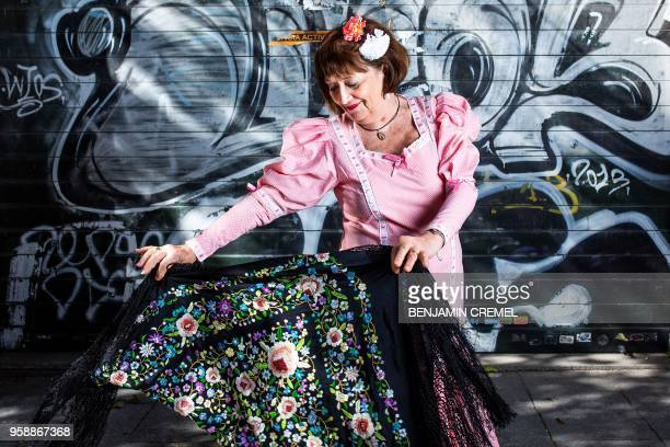 TOPSHOT Spanish Ines dressed in traditional chulapa garb for San Isidro celebrations poses in Madrid on May 15 2018