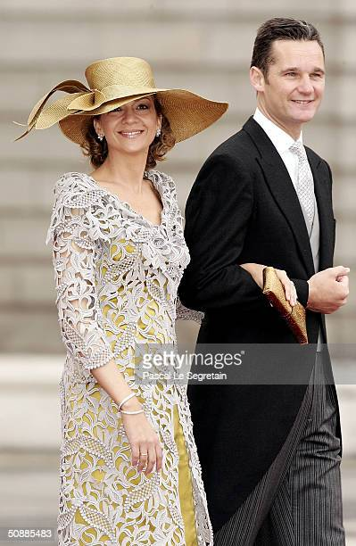 Spanish Infanta Cristina and her husband Inaki Urdangarin walk towards the Almudena cathedral to attend the wedding between his son, Spanish Crown...
