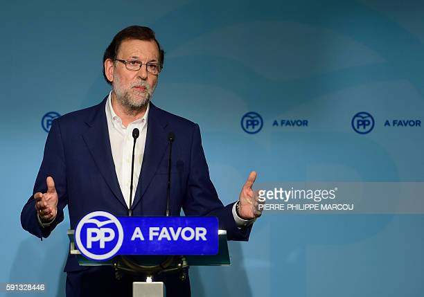Spanish interim Prime Minister Mariano Rajoy gestures during a press conference in Madrid on August 17 2016 Spain's corruptionhit ruling Popular...