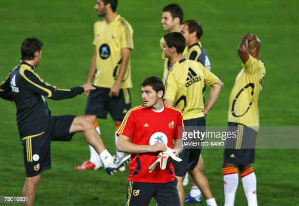 Spanish international football goalkeeper Iker Casillas warms up with teammates during a training session on the eve of their Euro 2008 Group F...