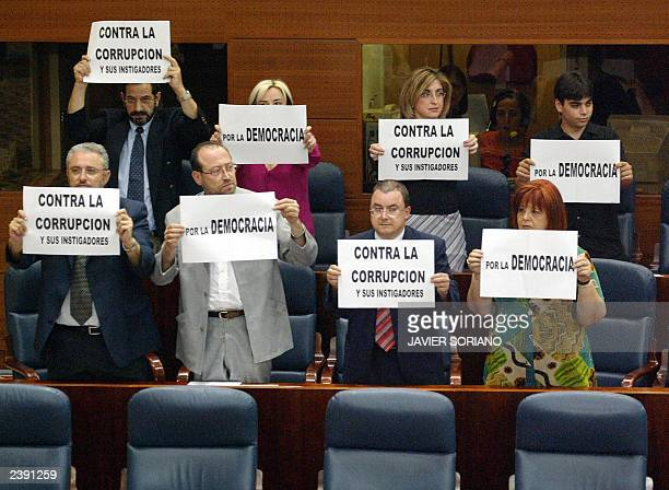 Spanish Izquierda Unida Party deputies show placards against corruption and for democracy at the Spanish Parliament 23 June 2003 Spanish Socialist...