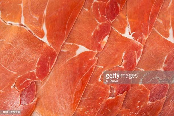 spanish jamon iberico sliced, as a background - iberian stock photos and pictures