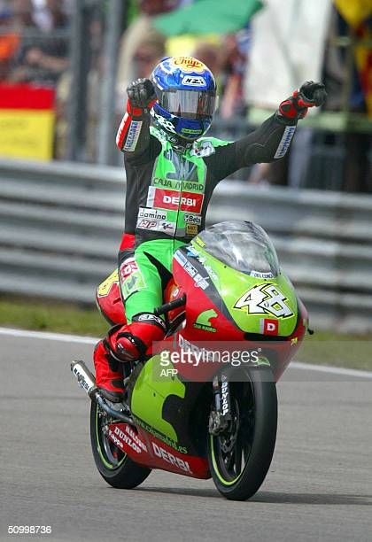 Spanish Jorge Lorenzo celebrates his win of the Dutch Grand Prix 125 cc competition in Assen 26 June 2004 AFP/CONTINENTAL
