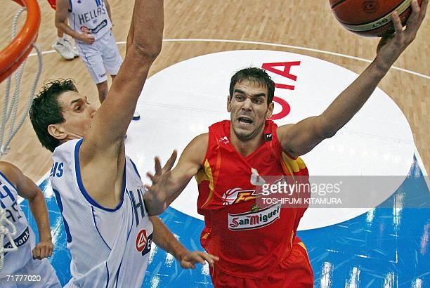 Spanish Jose-Manuel Calderon of the NBA's Toronto Raptors goes for a basket as Greek Dimitrios Diamantidis tries to block during the final of the...