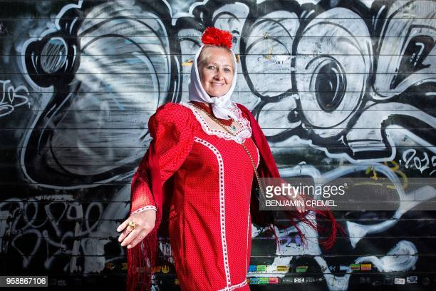 Spanish Julia dressed in traditional chulapa garb for San Isidro celebrations poses in Madrid on May 15 2018