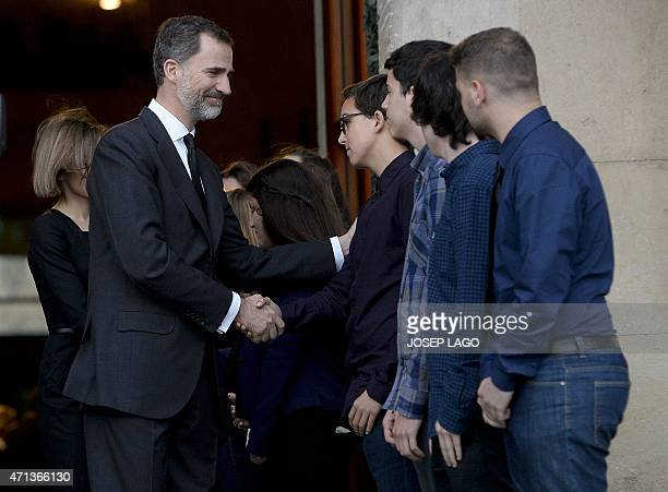 Spanish King Felipe and his wife Queen Letizia greet students which had hosted 16 German teenagers who resulted killed in Germanwings plane crash in...