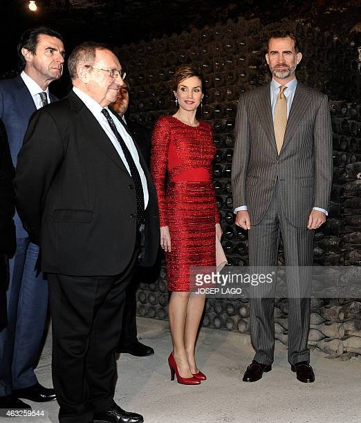 Spanish King Felipe and his wife Queen Letizia pose with honorary president of Spanish winery Freixenet Jose Luis Bonet and Spanish minister of...