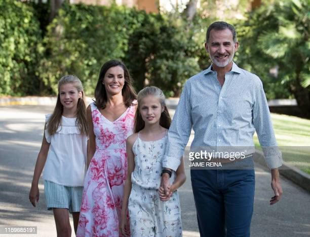 Spanish King Felipe VI and Queen Letizia arrive with their daughters Spanish Crown Princess Leonor and Princess Sofia in the gardens at the Marivent...