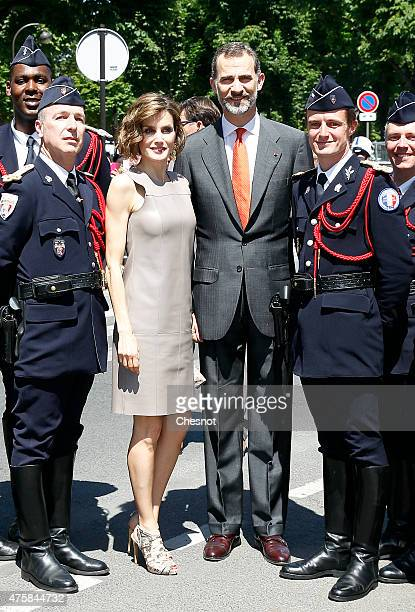 Spanish King Felipe VI and Queen Letizia pose with motorcyclists of the French National Police after their visit of the exhibition named 'Lumiere '...