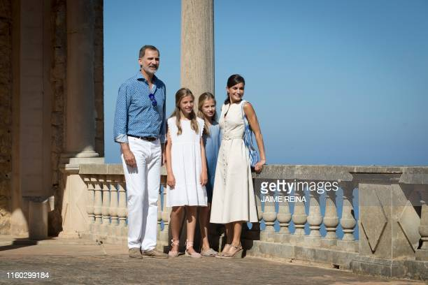 Spanish King Felipe VI and Queen Letizia pose with their daughters Spanish Crown Princess Leonor and Princess Sofia during a visit to the Son Marroig...
