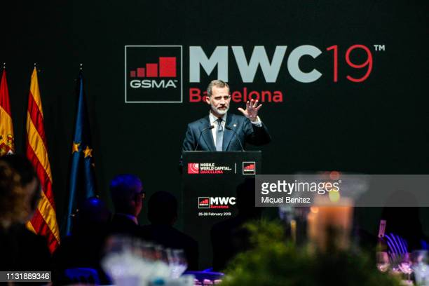 Spanish King Felipe VI attends a dinner at the National Art Museum of Catalonia to mark the inauguration of the Mobile World Congress on the eve of...