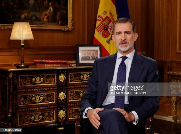Spanish King Felipe VI delivers his Christmas Eve message at the Zarzuela Palace in Madrid on December 24, 2019.