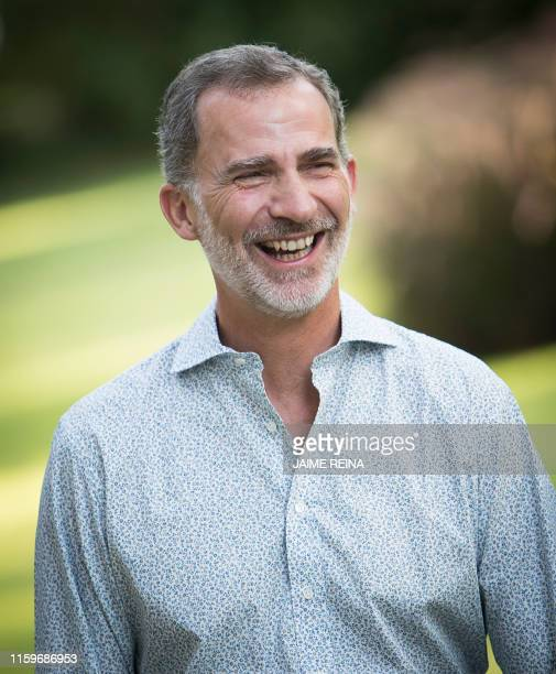Spanish King Felipe VI laughs as he poses in the gardens at the Marivent palace on the island of Majorca on August 4, 2019. - The Spanish royal...