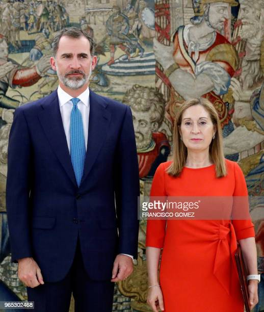 Spanish King Felipe VI poses with president of Spanish Parliament Ana Pastor before holding a meeting to be informed of the election of Pedro Sanchez...