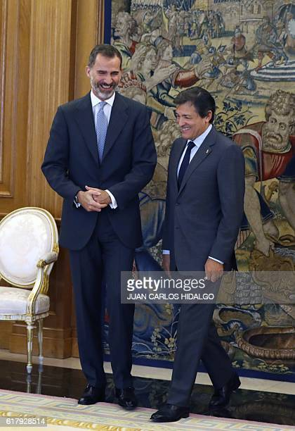 Spanish King Felipe VI poses with President of the Management Committee of the Spanish Socialist Party Javier Fernandez at the Zarzuela palace in...