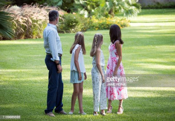 Spanish King Felipe VI , Queen Letizia and their daughters Spanish Crown Princess Leonor and Princess Sofia look behind them as they pose in the...
