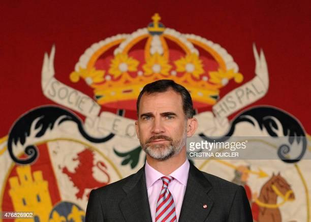 Spanish King Felipe VI stands during a presentation of the Real Maestranza Caballeria university awards in Sevilla on June 12 2015 Spain's King...