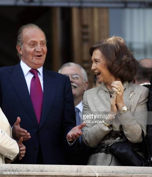 Spanish King Juan Carlos and his wife Queen Sofia joke at the city hall balcony during the mascleta of the Fallas festival in Valencia 15 March 2006...