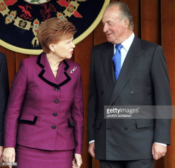 Spanish King Juan Carlos chats with Latvia 's Republic President Vaira Vike Freiberga as they view the Royal Guard parade 18 October 2004 at Pardo...
