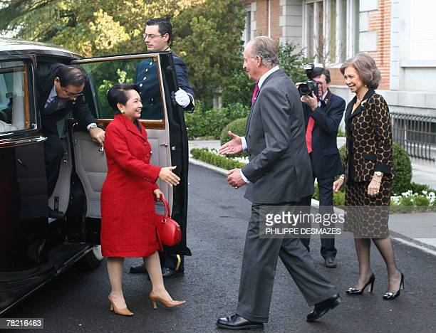 Spanish King Juan Carlos flanked by his wife Queen Sofia is about to greet Filippino President Gloria MacapagalArroyo as her husband Jose Miguel...