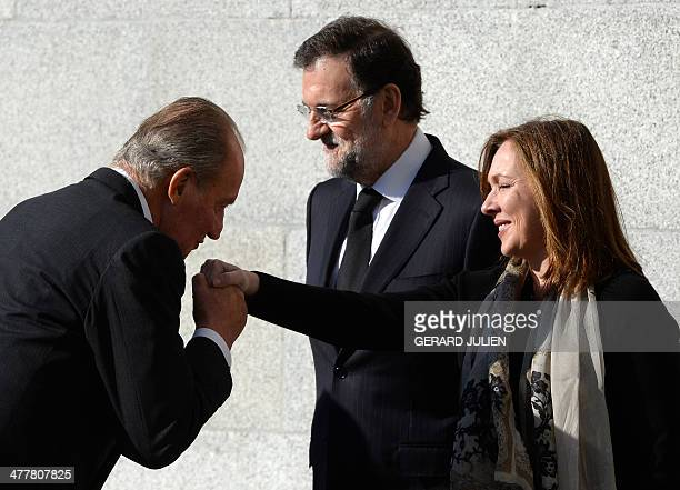 Spanish King Juan Carlos greets Spanish Prime Minister Mariano Rajoy's wife Elvira Fernandez Balboa before a commemorative mass held for the victims...