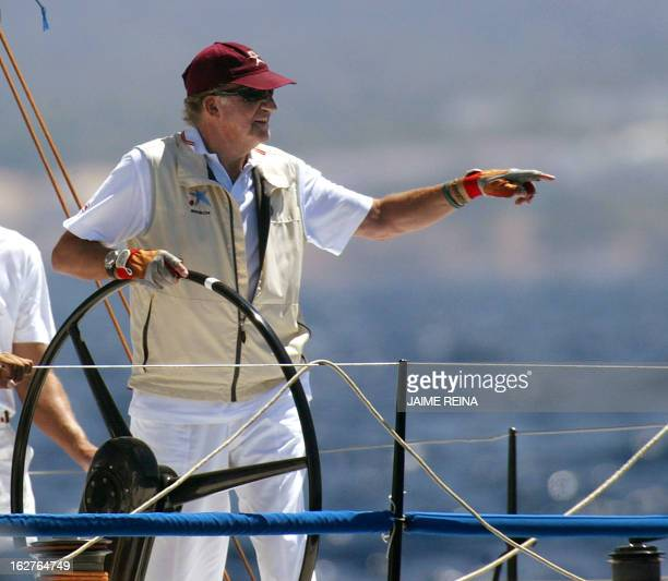 Spanish King Juan Carlos l gestures at the helm of Bribon during the last stage of 24th Copa del Rey of sailng in Palma de Mallorca 07 August 2005...
