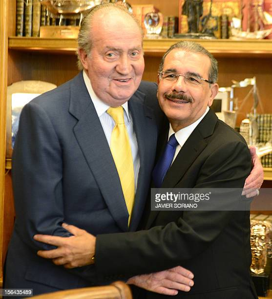 Spanish King Juan Carlos welcomes Dominican Republic President Danilo Medina Sanchez at the Zarzuela Palace in Madrid on November 15 ahead of the...