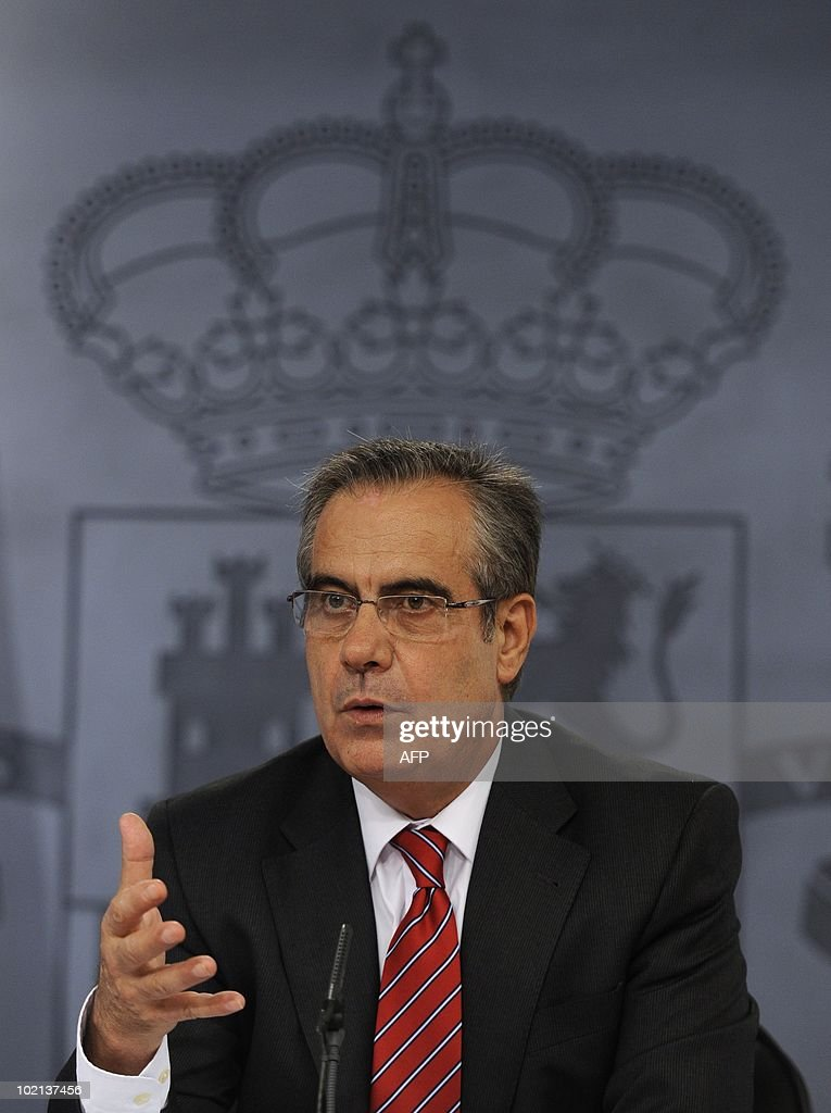 Spanish Labour and Immigration Minister Celestino Corbacho gives a joint press conference with Spanish Deputy Prime Minister Maria Teresa Fernandez de la Vega (not pictured) at the Moncloa palace in Madrid on June 16, 2010. Spain's socialist cabinet approved a contested reform of the labour market that is deemed crucial for reviving the economy, de la Vega said. The reform -- which makes it easier and cheaper for firms to fire workers -- must still be approved by parliament, where the government is seven seats short of a majority.