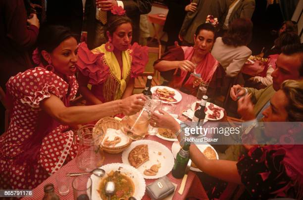 Spanish ladies feast at a private party in a marquee called a Caseta during the annual Feria de Abril on 11th June 1999 in Seville Andalucia Spain...