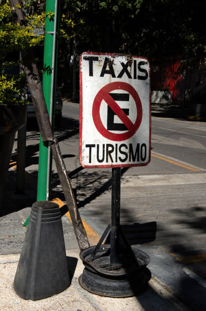 Spanish language 'No estacionamiento, taxis turismo' [No Parking, tourist taxis] sign on an inner city street in Mexico City, Mexico
