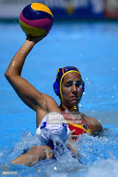 Spanish Laura Lopez tries to score despite Brazilian Cecilia Canetti during the waterpolo group D game Brazil vs Spain on July 23 2009 at the FINA...