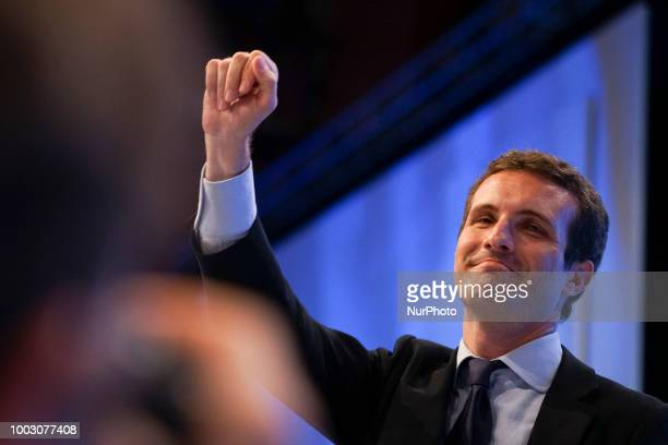 Spanish lawmaker Pablo Casado celebrates after being chosen as the next leader of Spain's Popular Party at the end of a party meeting in Madrid on...