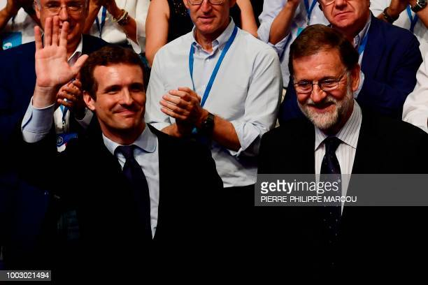 TOPSHOT Spanish lawmaker Pablo Casado celebrates after winning a Popular Party election to succeed former Spanish prime minister and outgoing PP...