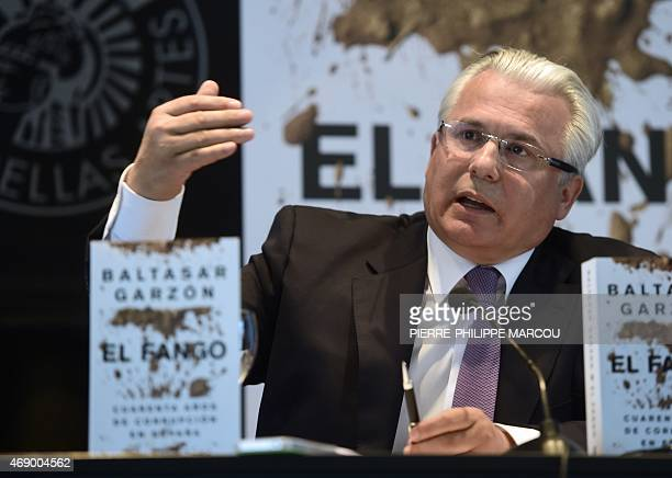 """Spanish Lawyer Baltasar Garzon gestures in Madrid on April 9, 2015 during the presentation of his book """"The mud, fourty years of corruption in..."""