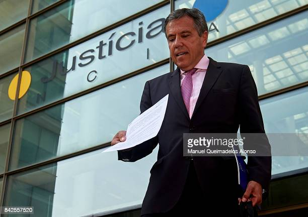 Spanish lawyer Fernando Osuna shows a copy of a lawsuit in front of the building the court at the City of Justice on September 4 2017 in Valencia...