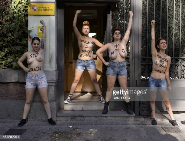 Spanish leader of feminist movement Femen Lara Alcazar and other members gestures during a demonstration staged in front the Ministry of the Interior...