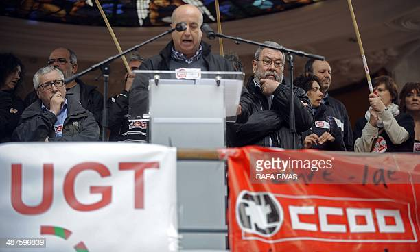 Spanish leader of the Workers' Commissions Union Ignacio Fernandez Toxo and leader of the General Union of Workers Candido Mendez listen to Raul Arza...