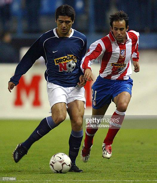 Spanish League Selection team Argentinian Juan Roman Riquelme vies with Atletico de Madrid's Carlos during a soccer friendly match 'Project Man No...