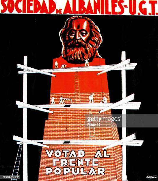 Spanish left wing election poster showing the construction of a giant statue of Karl Marx with the slogan ' Vote for the popular Front'