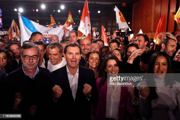 Spanish liberal Ciudadanos party leader and candidate for prime minister Albert Rivera gestures flanked by Ines Arrimadas and other party...