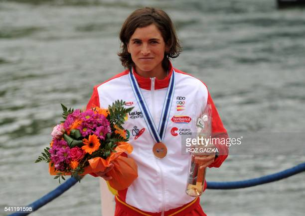 Spanish Maialen Chourraut celebrates on the podium of the women's slalom of the Worldcup Kayaking championships in Pau southwestern France on June 19...