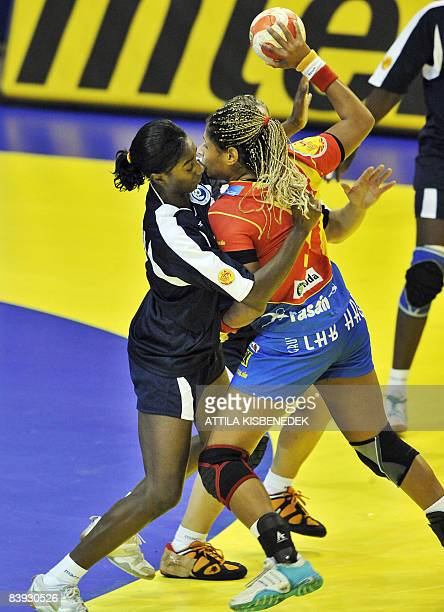 Spanish Marta Mangue fights with Portuguese Ana Miriam Sousa during the 8th Women's Handball European Championships match on December 5 in 'Biljanini...