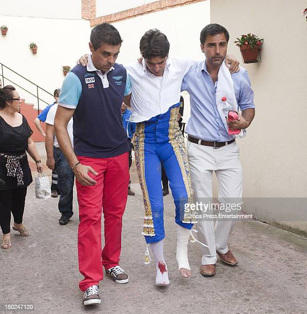 Spanish matador Cayetano Rivera Ordonez looks injured during a bullfight on August 12 2012 in Gijon Spain