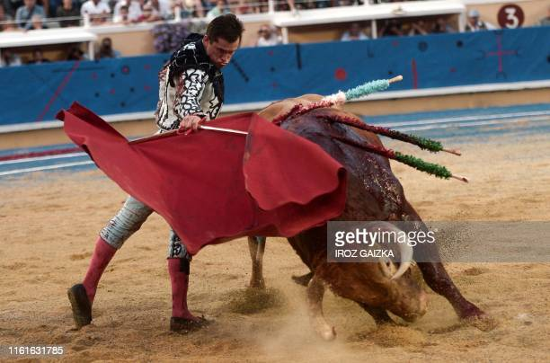TOPSHOT Spanish matador Daniel Luque performs a pass on a Pedraza de Yeltes bull at Marcel Dangou arena in Bayonne southwestern France on August 14...