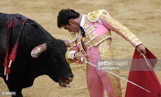 Spanish matador David Fandilla 'El Fandi' gives a pass with muleta to his Jandilla fighting bull during the fifth corrida of the San Fermin...