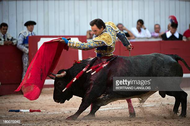 Spanish matador El Cid performs a pass to a La Quinta bull during a bullfight as part of the Rice feria in the Arles Arena southern France on...