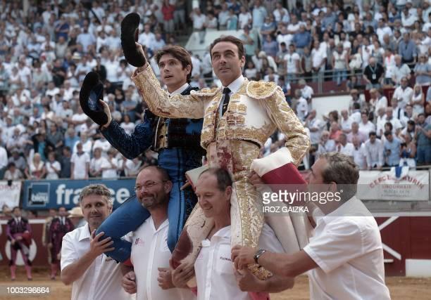 Spanish matador Enrique Ponce and French matador Sebastian Castella celebrate at Plumacon arena in Mont de Marsan during the festival of La Madeleine...
