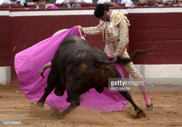 Spanish matador Enrique Ponce performs a pass on a Nunez Del Cuvillo bull at Plumacon arena in Mont de Marsan during the festival of La Madeleine...