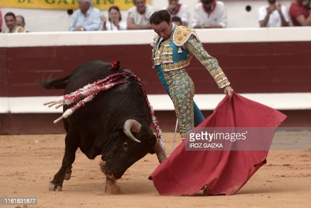 Spanish matador Enrique Ponce performs a pass on a Victoriano Del Rio bull at Dax arena during the Dax Feria southwestern France on August 15 2019...